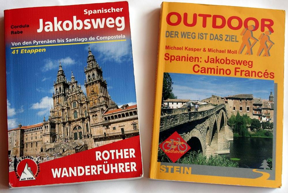 Zwei Pilgerführer im Bild für den Jakobsweg Camino Francés in Spanien